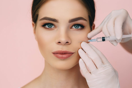 beauty injections into beautiful face. smoothing of mimic wrinkles near lips, biorevitalization on pink