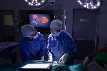 Surgeons performing operation in operating room at hospital