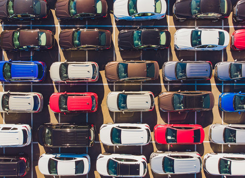 Top view of new cars lined up outside an automobile factory for import export.