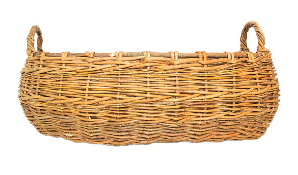 Large two-hand wicker basket made of wicker on a white background, isolate