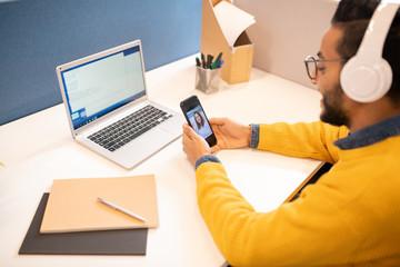 Fototapeta Talking via videoconferencing on phone obraz