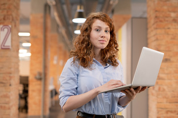 Confident young woman with laptop