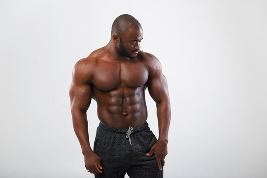 African American Athlete posing in studio. Shows body muscles