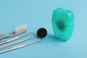 Wall Mural - dental tools on blue background top view