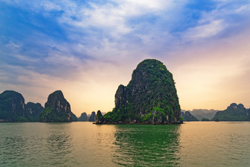 Green mountain isles in Ha Long bay at sunset