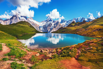 Scenic view on Bernese range above Bachalpsee lake. Popular tourist attraction. Location place Swiss alps, Grindelwald valley, Europe.