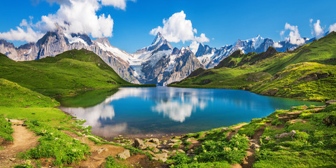 Scenic view on Bernese range above Bachalpsee lake. Popular tourist attraction. Location place Swiss alps, Grindelwald valley, Europe.  Fototapete