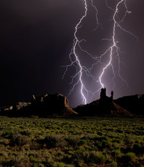 Composite photo of lightning striking Valley of the Gods in Utah, United States of America, North America
