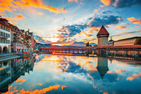 Sunset in historic city center of Lucerne with famous Chapel Bridge and lake Lucerne (Vierwaldstattersee), Canton of Lucerne, Switzerland