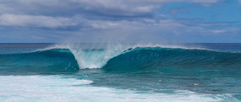 Turquoise breaking wave approaching the shoreline of beautiful Easter Island.
