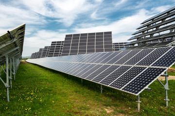 Solar panels, photovoltaics, with sun tracking systems -  alternative electricity source, concept of sustainable resources