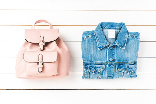 Women's backpack and jeans jacket. Top view