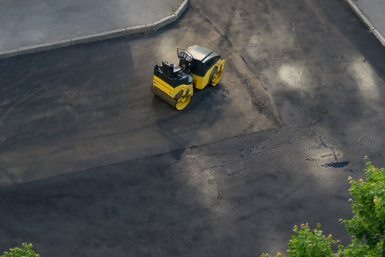 car for repairing the roadway in the city, top view