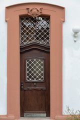 beautiful wooden door with metal ornaments in the historic part of the German city of Mainz