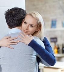 Young woman embracing man