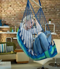 Woman in hammock using tablet