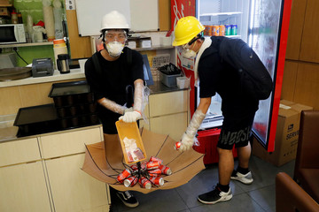 Anti-extradition bill protesters leave money as they grab cans of soda drink inside an empty canteen as as they break into the Legislative Council building during the anniversary of Hong Kong's handover to China in Hong Kong