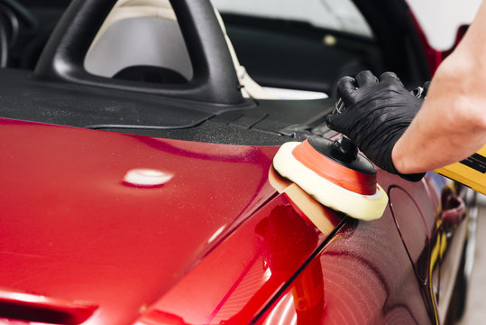Close up of person cleaning car exterior