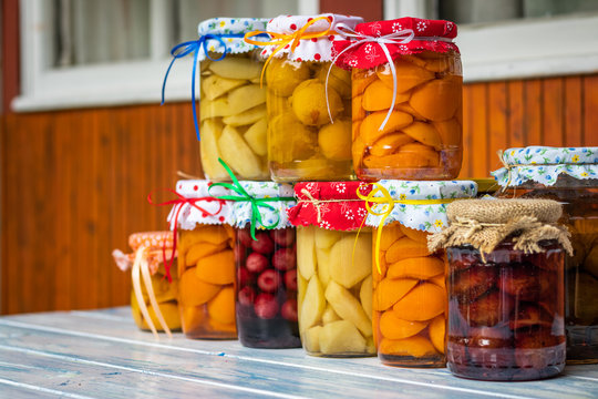 Preserved food in jar, homemade fruit compote
