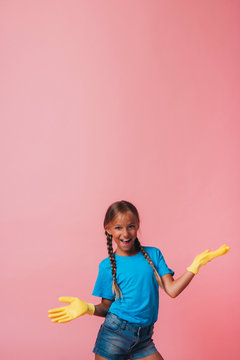 Little girl with yellow gloves