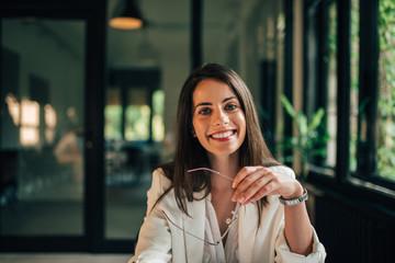 Portrait of successful young female entrepreneur.