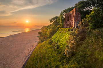 Sunrise over the ruins church in Trzesacz, Poland Wall mural