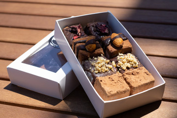 Raw vegan chocolate candies in the box
