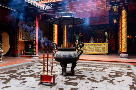 Incense sticks in large vase and large incense sticks at the foreground in Ong Bon Pagoda (Nhi Phu Mieu), Cho Lon Ho Chi Minh City, Vietnam.