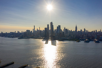 Wall Mural - New York cityscape with morning sunrise