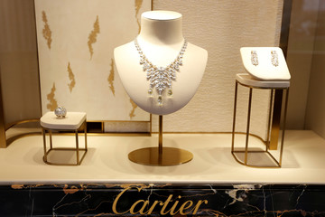 High jewellery are displayed at luxury goods maker Cartier store on Place Vendome in Paris