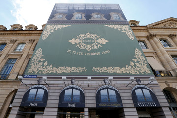 A view shows an advertising poster for the new high end jewellery Gucci store on Place Vendome in Paris