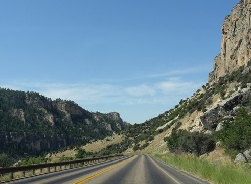Scenic drive with geologic formations and cliffs through the Bighorn Mountains in Wyoming, USA.