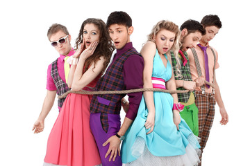 group of young people in bright clothes, tied with a rope.