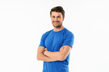 Attractive young fit sportsman wearing t-shirt standing Wall mural
