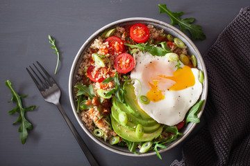 quinoa bowl with fried egg, avocado, tomato, rocket. Healthy vegetarian lunch