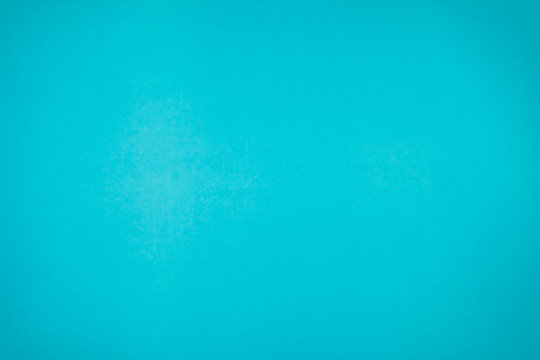 A little mottled bright blue turquoise paper plain and solid for minimal object background.