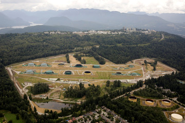 The Burnaby Terminal and Tank Farm, the terminus of the Trans Mountain Pipeline, is seen below Simon Fraser University in an aerial photo over the Burnaby Mountain