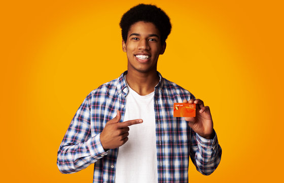 Happy Guy Holding Credit Card and Point on It
