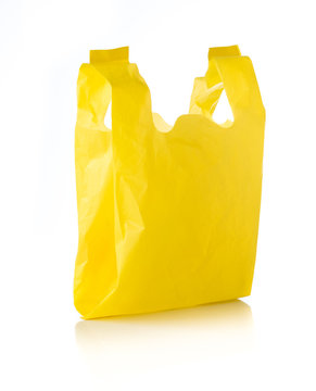 Yellow plastic bag isolated on white