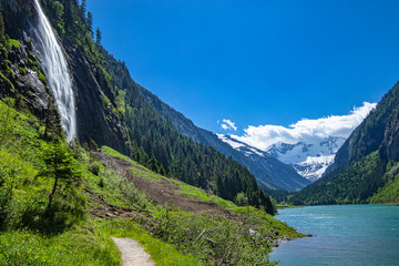 Wall Mural - Alps mountains with blue lake and waterfall. Photo taked at Stillup Lake, Austria, Tyrol Region