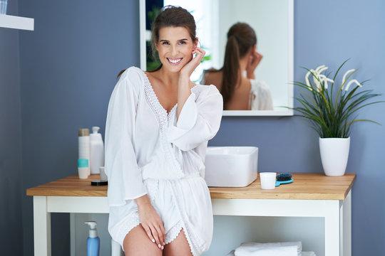 Beautiful brunette woman in the bathroom