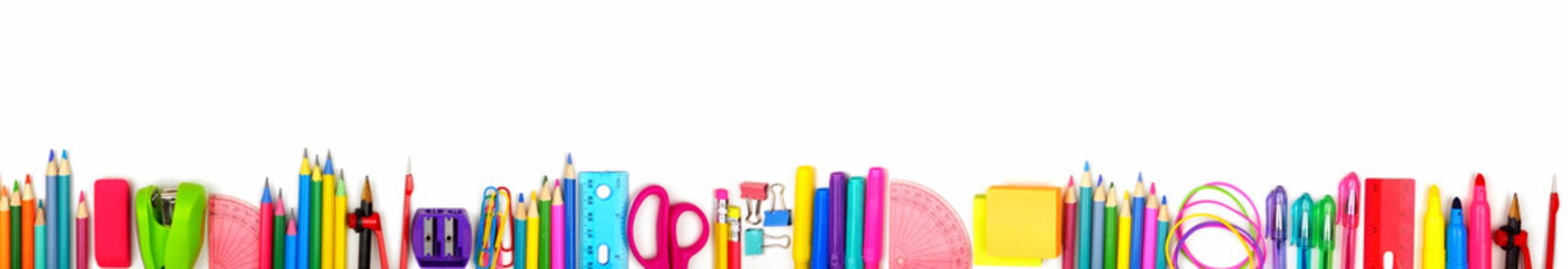 School supplies long bottom border. Top view isolated on a white background. Back to school concept.