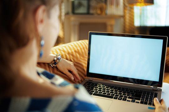 modern woman looking at laptop blank screen