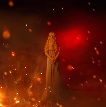 mistress of fire in red room full of flame and burning sparks, lady with long curled white blond hair in gray vintage dress, girl with hands behind her back, young woman with highlights and heat