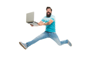 Fast internet. Technologies running world. Man run with modern laptop captured in motion. Never stop. Hipster surprised bearded web developer designer or programmer with laptop. Modern laptop concept Fototapete