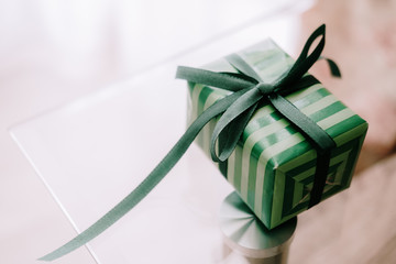 One small green color gift box