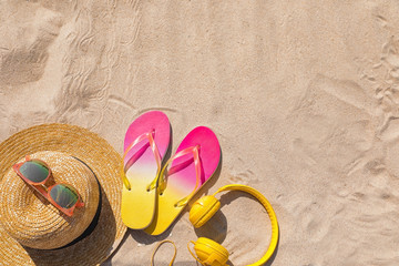 Different beach accessories on sand, top view with space for text. Summer vacation Wall mural