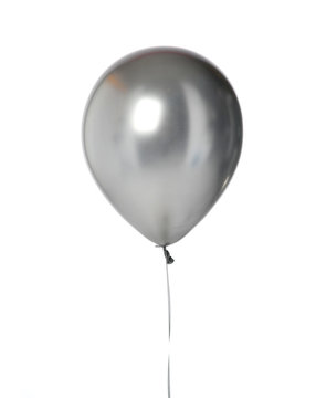 Big silver metallic latex balloon for birthday party isolated on a white