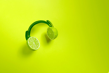 Green citrus headphones. Creative concept for summer parties.  Wall mural
