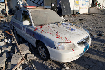 Blood stains are seen on a police car at a detention centre for mainly African migrants, hit by an airstrike in the Tajoura suburb of Tripoli